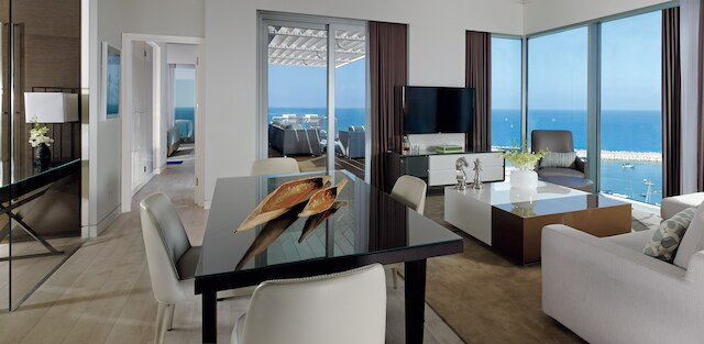Modern living room with 2 window walls and sea view