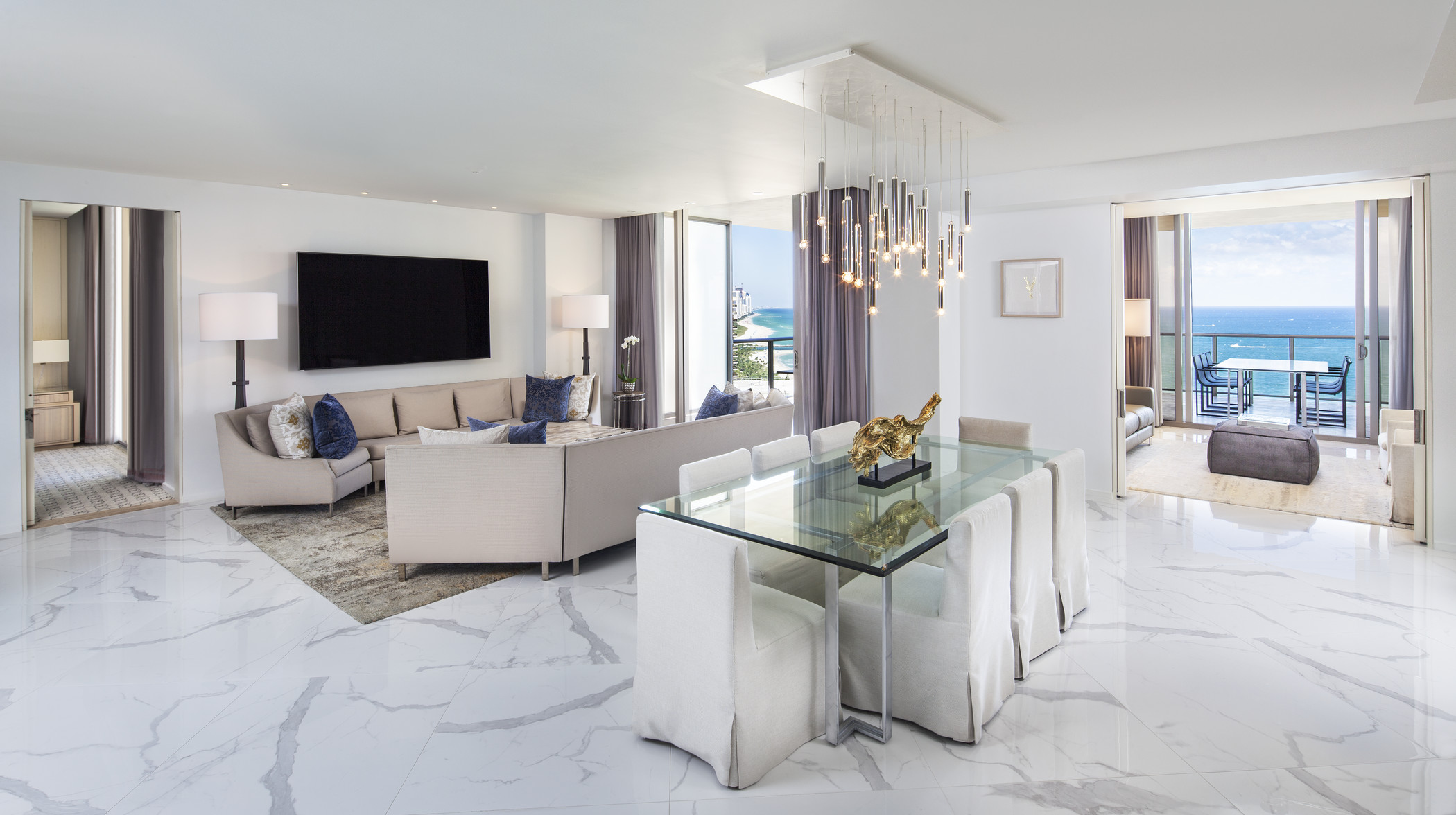 Large contemporary living and dining area with ocean view