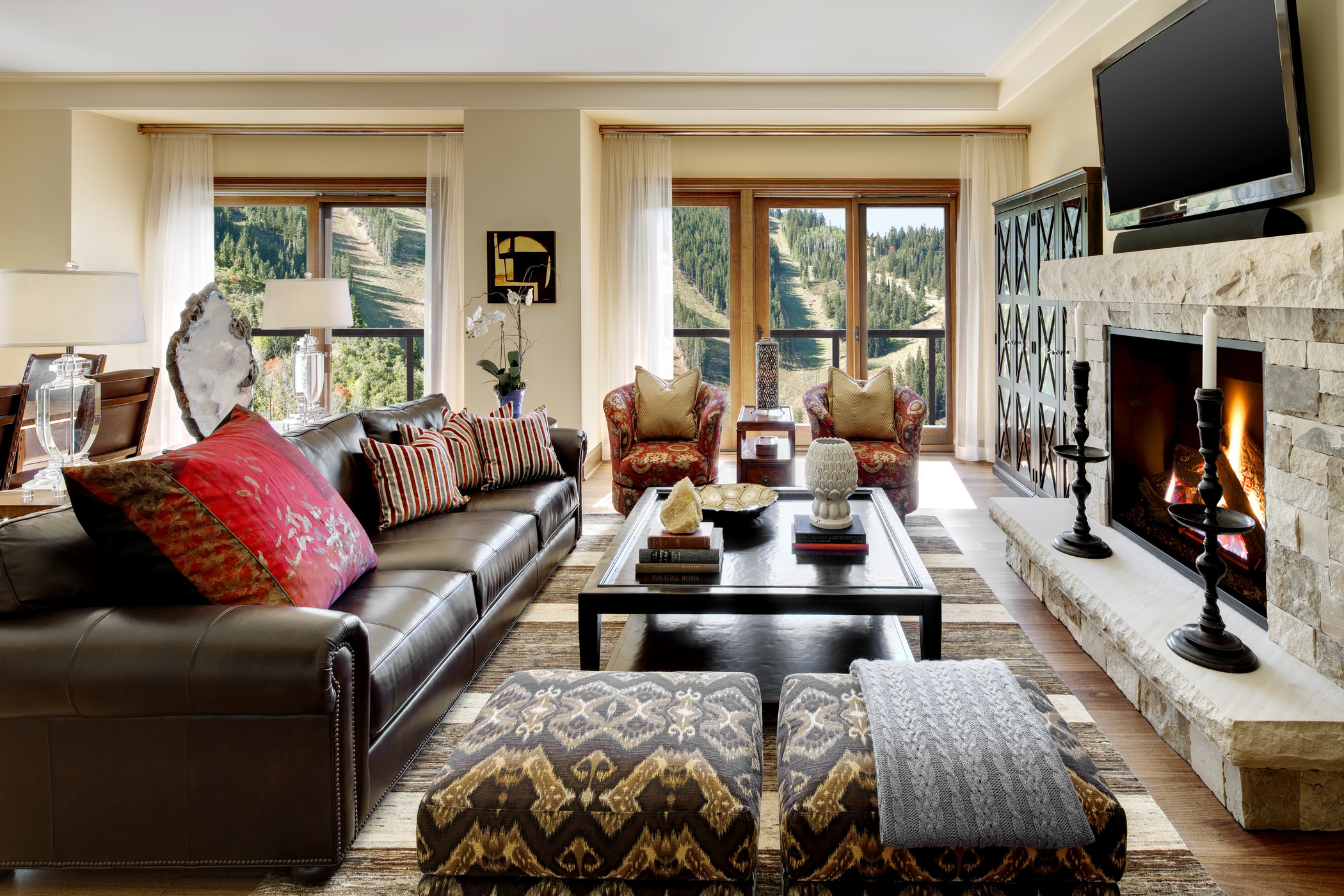 Living room with leather sofa and stone fireplace